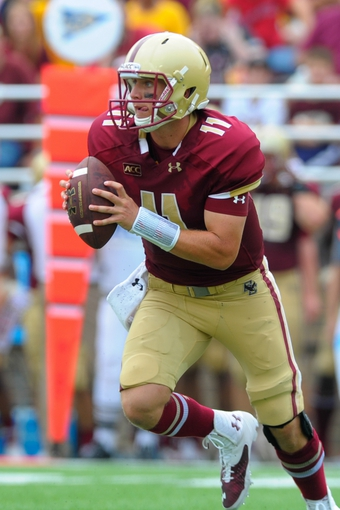 Aug 31, 2013; Boston, MA, USA; Boston College Eagles quarterback Chase Rettig (11) with the ball during the second half against the Villanova Wildcats at Alumni Stadium. Mandatory Credit: Bob DeChiara-USA TODAY Sports