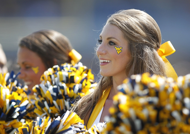Aug 31, 2013; Morgantown, WV, USA; West Virginia Mountaineers cheerleaders entertain the crowd against the William & Mary Tribe during the fourth quarter at Milan Puskar Stadium. The West Virginia Mountaineers won 24-17. Mandatory Credit: Charles LeClaire-USA TODAY Sports