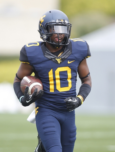 Aug 31, 2013; Morgantown, WV, USA; West Virginia Mountaineers wide receiver Jordan Thompson (10) on the field before playing the William & Mary Tribe at Milan Puskar Stadium. The West Virginia Mountaineers won 24-17. Mandatory Credit: Charles LeClaire-USA TODAY Sports