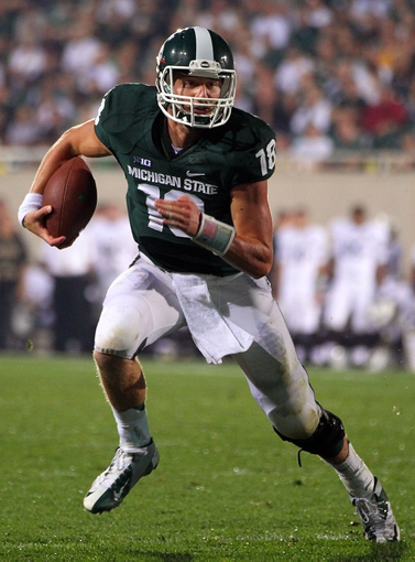 Aug 30, 2013; East Lansing, MI, USA; Michigan State Spartans quarterback Connor Cook (18) runs the ball against the Western Michigan Broncos during 1st half of a game at Spartan Stadium.   Mandatory Credit: Mike Carter-USA TODAY Sports