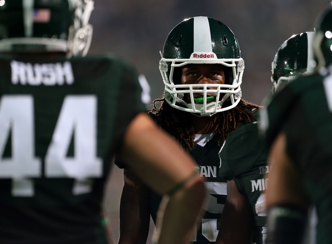 Aug 30, 2013; East Lansing, MI, USA; Michigan State Spartans defensive back Jalyn Powell (35) in a defensive huddle in a game against the Western Michigan Broncos during 2nd  half of a game at Spartan Stadium. MSU won 26-13.   Mandatory Credit: Mike Carter-USA TODAY Sports