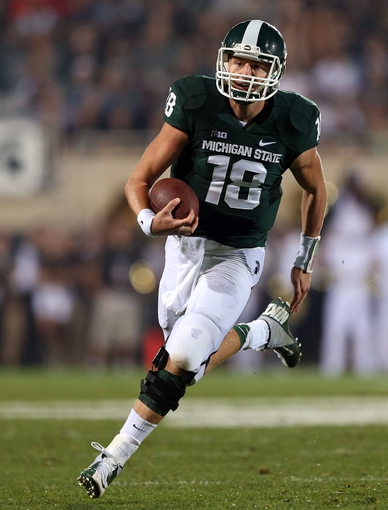 Aug 30, 2013; East Lansing, MI, USA;Michigan State Spartans quarterback Connor Cook (18) runs the ball during 2nd  half of a game at Spartan Stadium. MSU won 26-13.   Mandatory Credit: Mike Carter-USA TODAY Sports