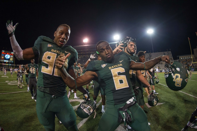Aug 31, 2013; Waco, TX, USA; Baylor Bears defensive end Jamal Palmer (92) and safety Ahmad Dixon (6) celebrate the win against the Wofford Terriers at Floyd Casey Stadium. The Bears defeated the Terriers 69-3. Mandatory Credit: Jerome Miron-USA TODAY Sports