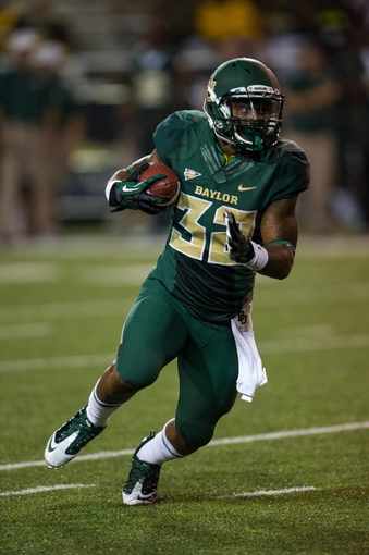 Aug 31, 2013; Waco, TX, USA; Baylor Bears running back Shock Linwood (32) runs with the ball during the game against the Wofford Terriers at Floyd Casey Stadium. The Bears defeated the Terriers 69-3. Mandatory Credit: Jerome Miron-USA TODAY Sports