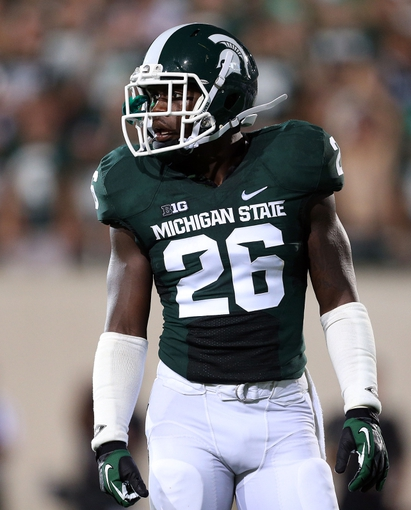Aug 30, 2013; East Lansing, MI, USA; Michigan State Spartans safety RJ Williamson (26) in a game against the Western Michigan Broncos during 2nd  half of a game at Spartan Stadium. MSU won 26-13.   Mandatory Credit: Mike Carter-USA TODAY Sports