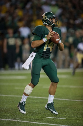 Aug 31, 2013; Waco, TX, USA; Baylor Bears quarterback Bryce Petty (14) drops back to pass during the game against the Wofford Terriers at Floyd Casey Stadium. The Bears defeated the Terriers 69-3. Mandatory Credit: Jerome Miron-USA TODAY Sports