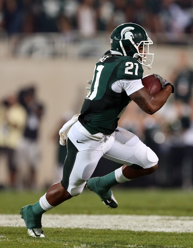 Aug 30, 2013; East Lansing, MI, USA; Michigan State Spartans wide receiver Andre Sims Jr. (21) returns a kickoff during 2nd  half of a game at Spartan Stadium. MSU won 26-13.   Mandatory Credit: Mike Carter-USA TODAY Sports