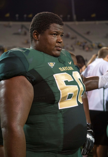 Aug 31, 2013; Waco, TX, USA; Baylor Bears offensive linesman LaQuan McGowan (60) during the game against the Wofford Terriers at Floyd Casey Stadium. The Bears defeated the Terriers 69-3. Mandatory Credit: Jerome Miron-USA TODAY Sports