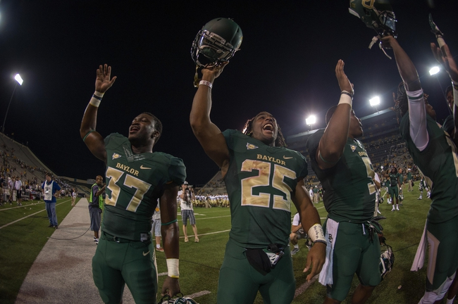 Aug 31, 2013; Waco, TX, USA; Baylor Bears cornerback Josh Benenoch (37) and running back Lache Seastrunk (25) celebrate the win against the Wofford Terriers at Floyd Casey Stadium. The Bears defeated the Terriers 69-3. Mandatory Credit: Jerome Miron-USA TODAY Sports
