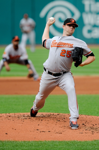 Sep 2, 2013; Cleveland, OH, USA; Baltimore Orioles starting pitcher Bud Norris (25) pitches against the Cleveland Indians at Progressive Field. Mandatory Credit: Ken Blaze-USA TODAY Sports