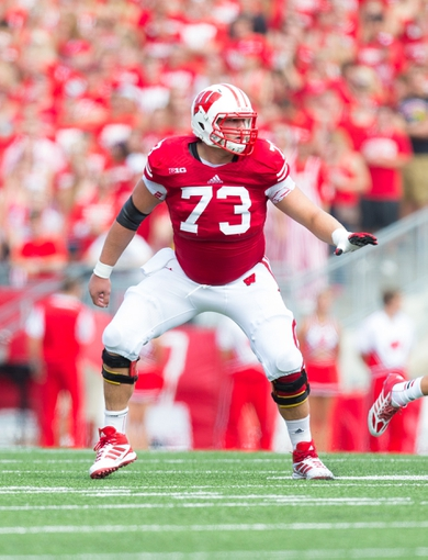 Aug 31, 2013; Madison, WI, USA; Wisconsin Badgers offensive lineman Dallas Lewallen (73) during the game against the Massachusetts Minutemen at Camp Randall Stadium.  Wisconsin won 45-0.  Mandatory Credit: Jeff Hanisch-USA TODAY Sports