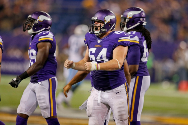 Aug 29, 2013; Minneapolis, MN, USA; Minnesota Vikings defensive tackle Spencer Nealy (64) celebrates the turnover by the Tennessee Titans in the fourth quarter at Mall of America Field at H.H.H. Metrodome. Vikings win 24-23. Mandatory Credit: Bruce Kluckhohn-USA TODAY Sports