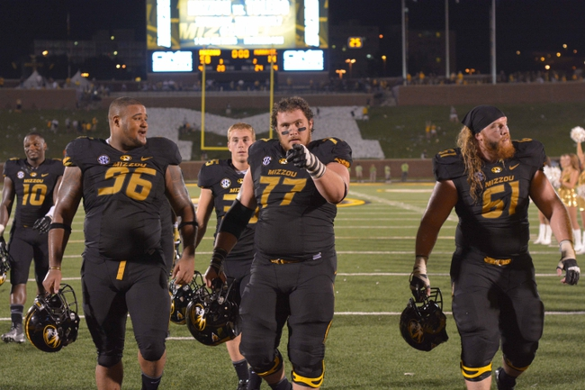 Aug 31, 2013; Columbia, MO, USA; Missouri Tigers defensive lineman Lucas Vincent (96), offensive linesman Evan Boehm (77), and offensive linesman Max Copeland (61) leave the field after the game against the Murray State Racers at Faurot Field. Missouri won 58-14. Mandatory Credit: Denny Medley-USA TODAY Sports