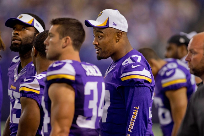 Aug 29, 2013; Minneapolis, MN, USA; Minnesota Vikings defensive end Everson Griffen (97) talks along the sidelines in the game with the Tennessee Titans at Mall of America Field at H.H.H. Metrodome. Vikings win 24-23. Mandatory Credit: Bruce Kluckhohn-USA TODAY Sports