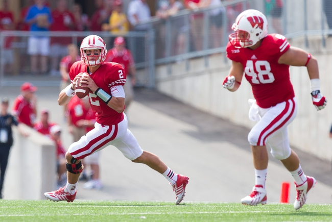 Aug 31, 2013; Madison, WI, USA; Wisconsin Badgers quarterback Joel Stave (2) rolls out of the pocket during the game against the Massachusetts Minutemen at Camp Randall Stadium.  Wisconsin won 45-0.  Mandatory Credit: Jeff Hanisch-USA TODAY Sports