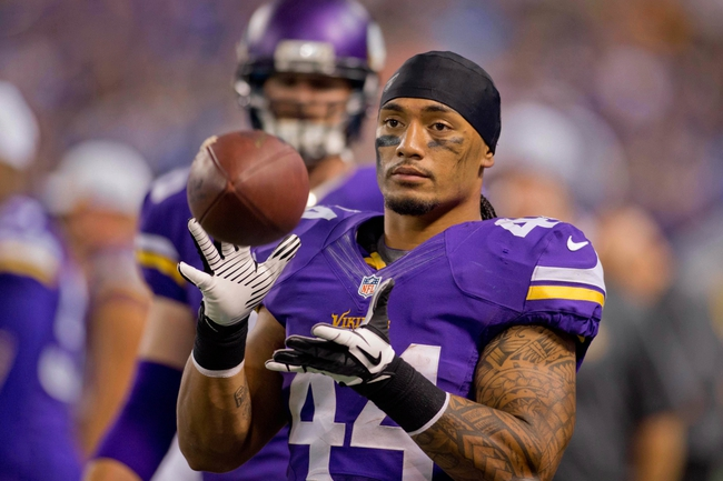 Aug 29, 2013; Minneapolis, MN, USA; Minnesota Vikings running back Matt Asiata (44) catches a ball along the sidelines in the game with the Tennessee Titans at Mall of America Field at H.H.H. Metrodome. Vikings win 24-23. Mandatory Credit: Bruce Kluckhohn-USA TODAY Sports