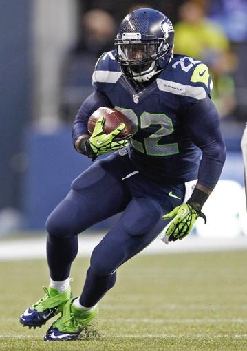 Aug 29, 2013; Seattle, WA, USA; Seattle Seahawks running back Robert Turbin (22) rushes against the Oakland Raiders during the second quarter at CenturyLink Field. Mandatory Credit: Joe Nicholson-USA TODAY Sports