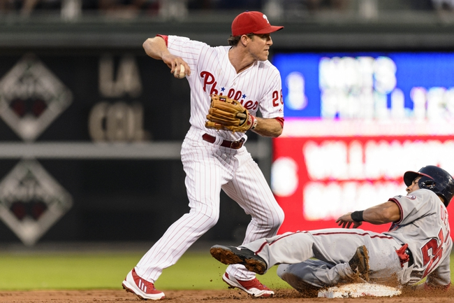 Sep 4, 2013; Philadelphia, PA, USA; Philadelphia Phillies second baseman Chase Utley (26) throws to first base to turn the double play after forcing Washington Nationals shortstop Ian Desmond (20) at second base during the first inning at Citizens Bank Park. Mandatory Credit: Howard Smith-USA TODAY Sports