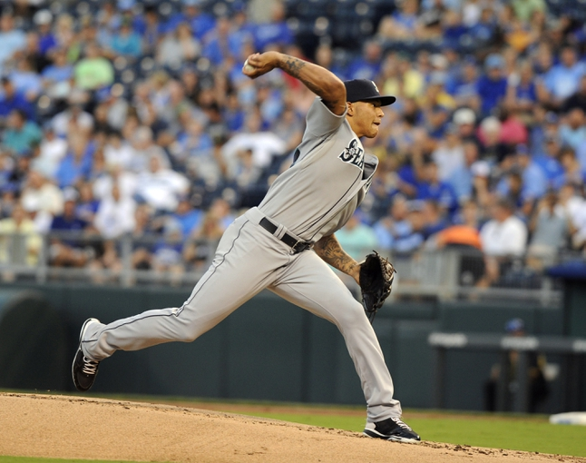 Sep 4, 2013; Kansas City, MO, USA; Seattle Mariners starting pitcher Taijuan Walker (27) delivers a pitch in the first inning against the Kansas City Royals at Kauffman Stadium. Mandatory Credit: John Rieger-USA TODAY Sports