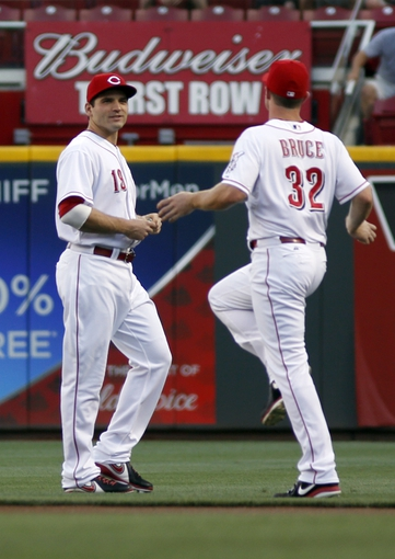 Sep 4, 2013; Cincinnati, OH, USA; Cincinnati Reds first baseman Joey Votto (19) and right fielder Jay Bruce (32) warm up prior to a game with the St. Louis Cardinals at Great American Ball Park. Mandatory Credit: David Kohl-USA TODAY Sports