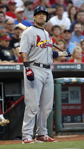 Sep 4, 2013; Cincinnati, OH, USA; St. Louis Cardinals catcher Yadier Molina gets ready on deck during a game against the Cincinnati Reds at Great American Ball Park. Mandatory Credit: David Kohl-USA TODAY Sports