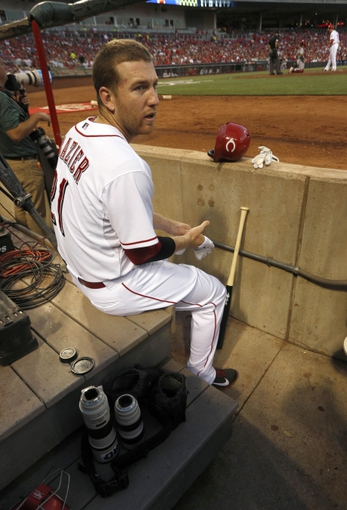 Sep 4, 2013; Cincinnati, OH, USA; Cincinnati Reds third baseman Todd Frazier sits in the camera area as he gets ready to bat during a game against the St. Louis Cardinals at Great American Ball Park. Mandatory Credit: David Kohl-USA TODAY Sports