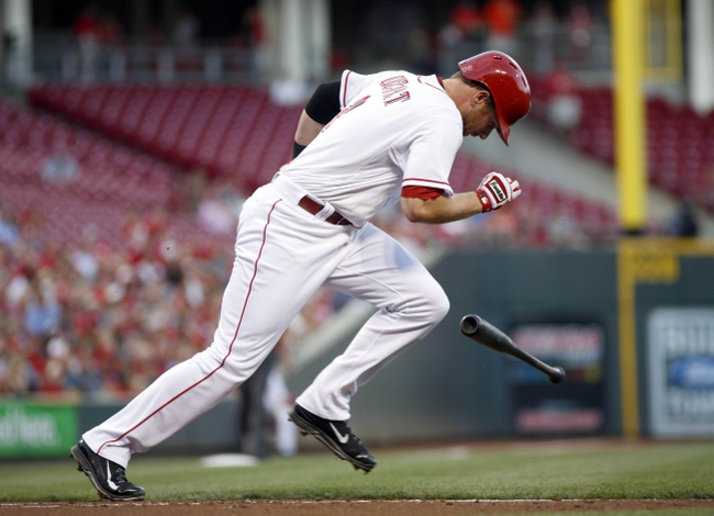 Sep 4, 2013; Cincinnati, OH, USA; Cincinnati Reds shortstop Zack Cozart runs to first base after hitting a single off St. Louis Cardinals starting pitcher Shelby Miller in the second inning at Great American Ball Park. Mandatory Credit: David Kohl-USA TODAY Sports