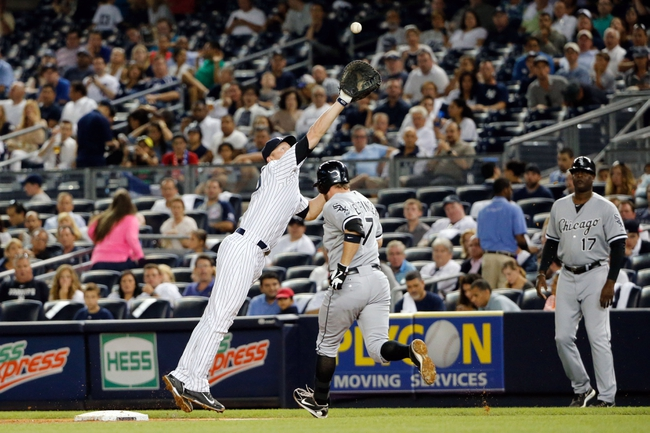 Sep 4, 2013; Bronx, NY, USA;  Chicago White Sox second baseman Jeff Keppinger (7) goes safe to second as the ball is overthrown to New York Yankees first baseman Lyle Overbay (55) during the fourth inning at Yankee Stadium. Mandatory Credit: Anthony Gruppuso-USA TODAY Sports