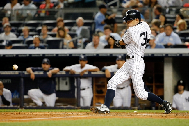 Sep 4, 2013; Bronx, NY, USA; New York Yankees right fielder Ichiro Suzuki (31) reaches first on a throwing error during the fourth inning against the Chicago White Sox at Yankee Stadium. Mandatory Credit: Anthony Gruppuso-USA TODAY Sports