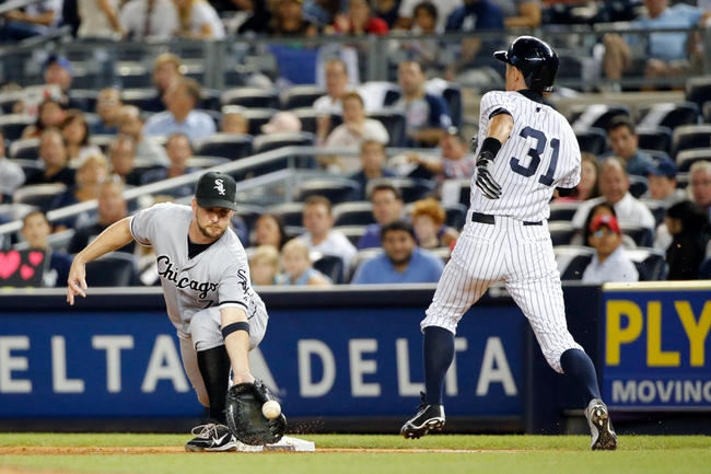 Sep 4, 2013; Bronx, NY, USA; New York Yankees right fielder Ichiro Suzuki (31) is safe at first as Chicago White Sox second baseman Jeff Keppinger (7) misses the catch during the fourth inning at Yankee Stadium. Mandatory Credit: Anthony Gruppuso-USA TODAY Sport