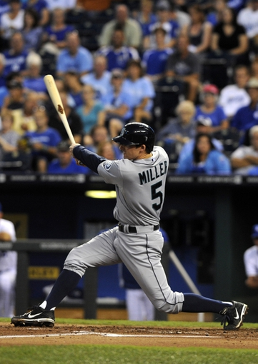 Sep 4, 2013; Kansas City, MO, USA; Seattle Mariners shortstop Brad Miller (5) drives in a run with a hit against the Kansas City Royals in the third inning at Kauffman Stadium. Mandatory Credit: John Rieger-USA TODAY Sports