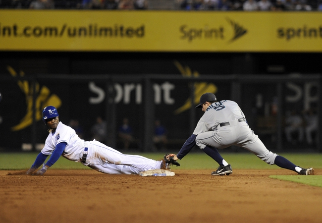 Sep 4, 2013; Kansas City, MO, USA; Seattle Mariners shortstop Brad Miller (5) tags out Kansas City Royals center fielder Jarrod Dyson (1) as he slides past second base while trying to steal in the fourth inning at Kauffman Stadium. Mandatory Credit: John Rieger-USA TODAY Sports