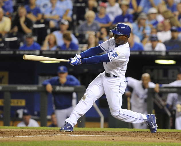 Sep 4, 2013; Kansas City, MO, USA; Kansas City Royals center fielder Jarrod Dyson (1) drives in two runs with a single against the Seattle Mariners in the fourth inning at Kauffman Stadium. Mandatory Credit: John Rieger-USA TODAY Sports