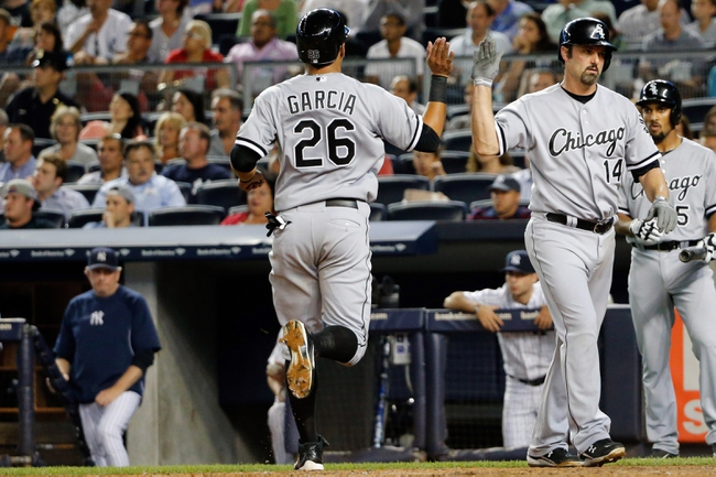 Sep 4, 2013; Bronx, NY, USA;  Chicago White Sox right fielder Avisail Garcia (26) and first baseman Paul Konerko (14) celebrate scoring during the eighth inning against the Chicago White Sox at Yankee Stadium. Yankees won 6-5.  Mandatory Credit: Anthony Gruppuso-USA TODAY Sports