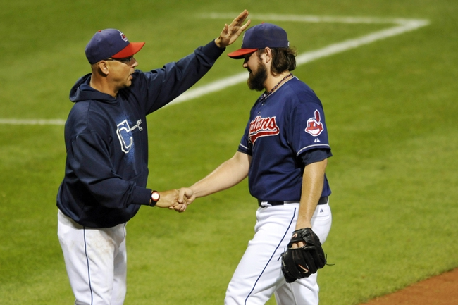 Sep 4, 2013; Cleveland, OH, USA; Cleveland Indians manager Terry Francona (left) and first baseman Nick Swisher (33) celebrate a 6-4 win over the Baltimore Orioles at Progressive Field. Mandatory Credit: David Richard-USA TODAY Sports