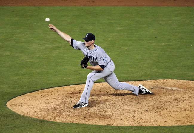 Sep 4, 2013; Kansas City, MO, USA; Seattle Mariners relief pitcher Carter Capps (58) delivers a pitch against the Kansas City Royals in the sixth inning at Kauffman Stadium. Mandatory Credit: John Rieger-USA TODAY Sports