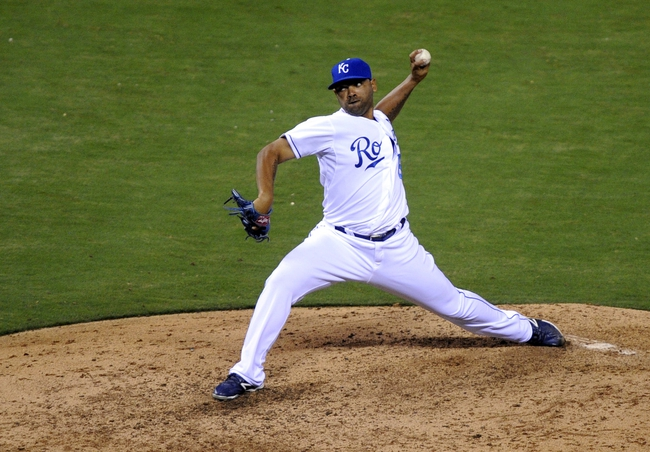 Sep 4, 2013; Kansas City, MO, USA; Kansas City Royals relief pitcher Francisley Bueno (67) delivers a pitch against the Seattle Mariners in the sixth inning at Kauffman Stadium. Mandatory Credit: John Rieger-USA TODAY Sports