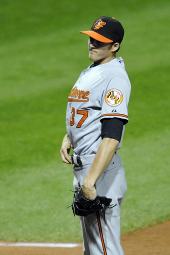 Sep 4, 2013; Cleveland, OH, USA; Baltimore Orioles starting pitcher Kevin Gausman (37) reacts after throwing a wild pitch in the fifth inning against the Cleveland Indians at Progressive Field. Mandatory Credit: David Richard-USA TODAY Sports