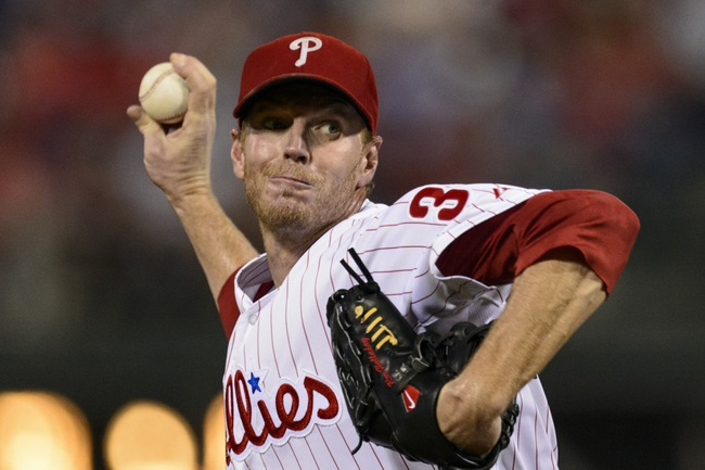 Sep 4, 2013; Philadelphia, PA, USA; Philadelphia Phillies pitcher Roy Halladay (34) delivers to the plate during the third inning against the Washington Nationals at Citizens Bank Park. The Nationals defeated the Phillies 3-2. Mandatory Credit: Howard Smith-USA TODAY Sports