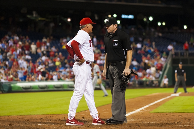 Sep 4, 2013; Philadelphia, PA, USA; Philadelphia Phillies interim manager Ryne Sandberg (23) discusses a play at the plate with home plate umpire Chris Conroy during the eighth inning against the Washington Nationals at Citizens Bank Park. The Nationals defeated the Phillies 3-2. Mandatory Credit: Howard Smith-USA TODAY Sports