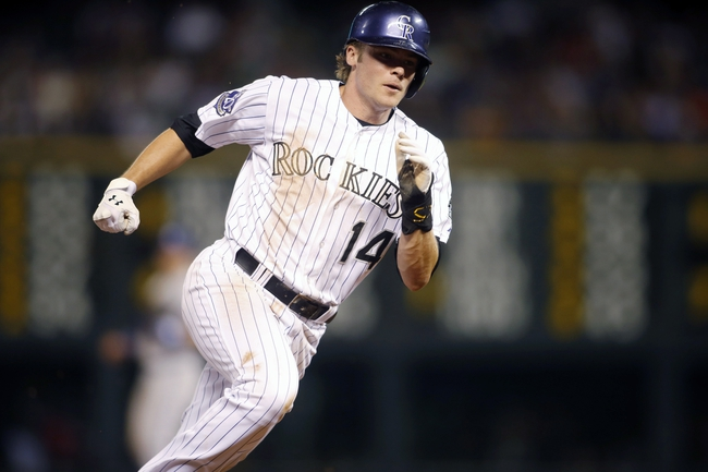 Sep 4, 2013; Denver, CO, USA; Colorado Rockies second baseman Josh Rutledge (14) rounds third base during the third inning against the Los Angeles Dodgers at Coors Field. Mandatory Credit: Chris Humphreys-USA TODAY Sports