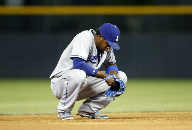 Sep 4, 2013; Denver, CO, USA; Los Angeles Dodgers shortstop Hanley Ramirez (13) reacts during the fifth inning against the Colorado Rockies at Coors Field. Mandatory Credit: Chris Humphreys-USA TODAY Sports