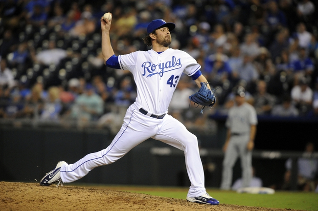 Sep 4, 2013; Kansas City, MO, USA; Kansas City Royals relief pitcher Aaron Crow (43) delivers a pitch in the ninth inning against the Seattle Mariners at Kauffman Stadium. Seattle won the game 6-4. Mandatory Credit: John Rieger-USA TODAY Sports