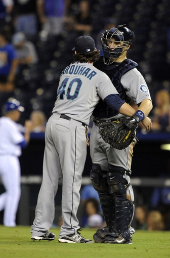 Sep 4, 2013; Kansas City, MO, USA; Seattle Mariners relief pitcher Danny Farquhar (40) celebrates with catcher Mike Zunino (3) after the game against the Kansas City Royals at Kauffman Stadium. Seattle won the game 6-4. Mandatory Credit: John Rieger-USA TODAY Sports