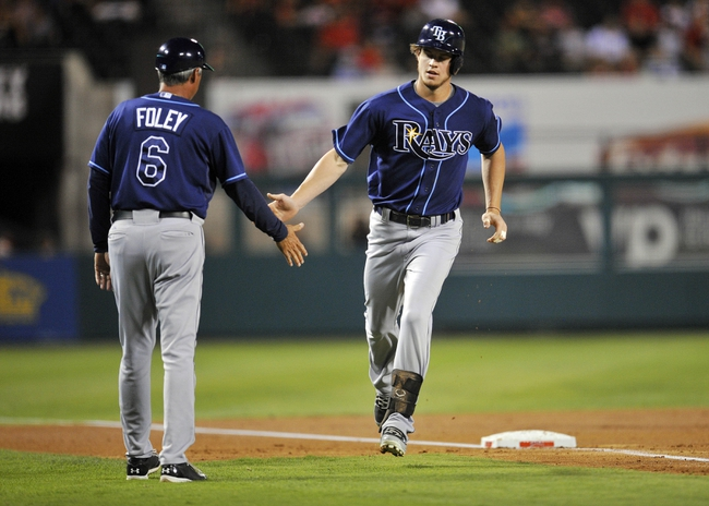 September 4, 2013; Anaheim, CA, USA; Tampa Bay Rays right fielder Wil Myers (9) is congratulated by third base coach Tom Foley (6) after hitting a solo home run during the second inning against the Los Angeles Angels at Angel Stadium of Anaheim. Mandatory Credit: Gary A. Vasquez-USA TODAY Sports