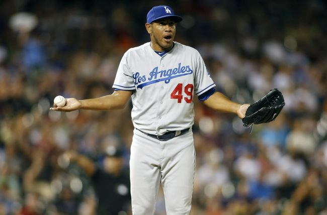 Sep 4, 2013; Denver, CO, USA; Los Angeles Dodgers pitcher Carlos Marmol (49) reacts after being called for a balk during the seventh inning against the Colorado Rockies at Coors Field. The Rockies won 7-5.  Mandatory Credit: Chris Humphreys-USA TODAY Sports