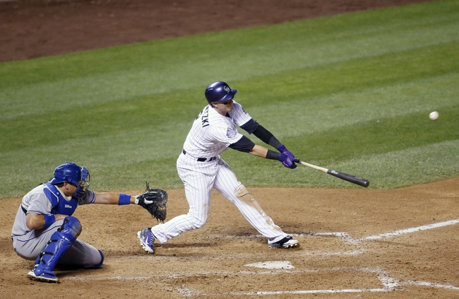 Sep 4, 2013; Denver, CO, USA; Colorado Rockies shortstop Troy Tulowitzki (2) hits sacrifice RBI during the seventh inning against the Los Angeles Dodgers at Coors Field. The Rockies won 7-5.  Mandatory Credit: Chris Humphreys-USA TODAY Sports