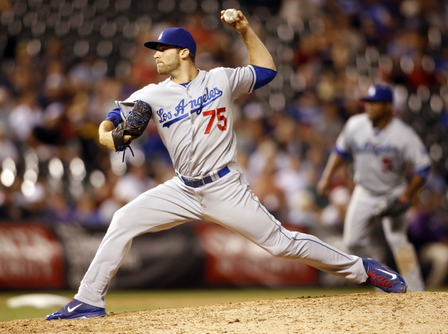Sep 4, 2013; Denver, CO, USA; Los Angeles Dodgers pitcher Paco Rodriguez (75) delivers a pitch during the eighth inning against the Colorado Rockies at Coors Field. The Rockies won 7-5.  Mandatory Credit: Chris Humphreys-USA TODAY Sports