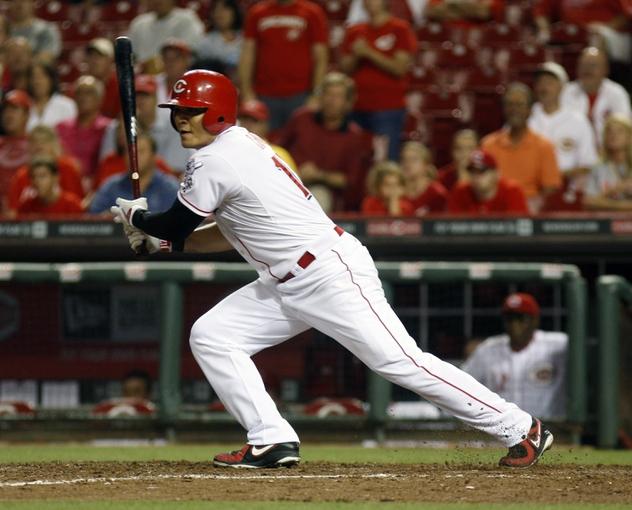 Sep 4, 2013; Cincinnati, OH, USA; Cincinnati Reds center fielder Shin-Soo Choo hits during a game against the St. Louis Cardinals at Great American Ball Park. Mandatory Credit: David Kohl-USA TODAY Sports