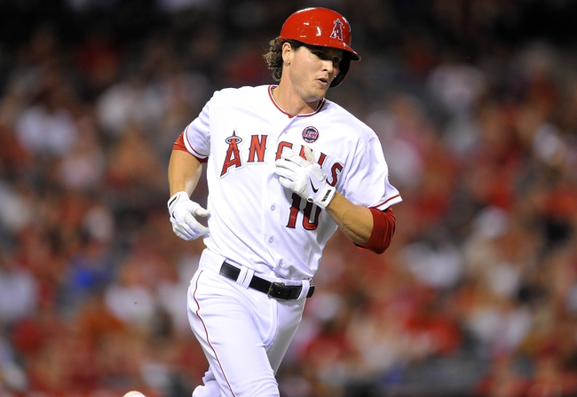 September 4, 2013; Anaheim, CA, USA; Los Angeles Angels second baseman Grant Green (10) runs after hitting a single during the fifth inning against the Tampa Bay Rays at Angel Stadium of Anaheim. Mandatory Credit: Gary A. Vasquez-USA TODAY Sports